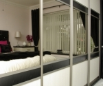 Sliding Robes with Avola white, bronze mirror & black textured wood all with Calgary champagne frames